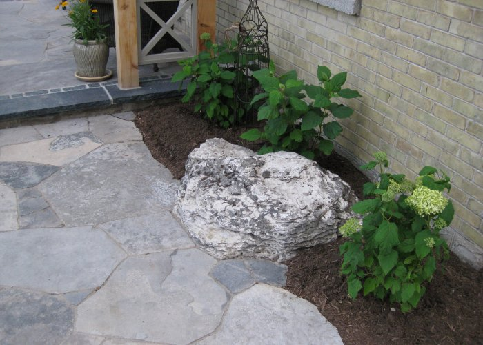 Boulder with Boarder Plantings