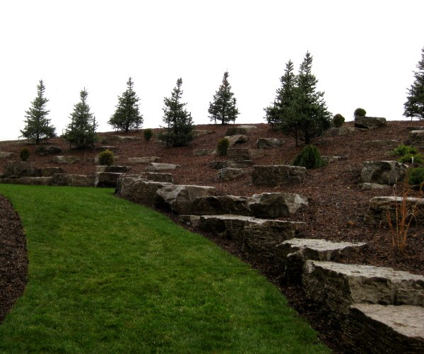 Decorative Rockery Retaining Wall with Privacy Trees