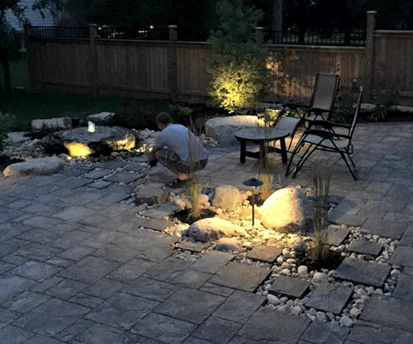 Paving Stone Patio with Lighted Rock Outcropping and Water Feature